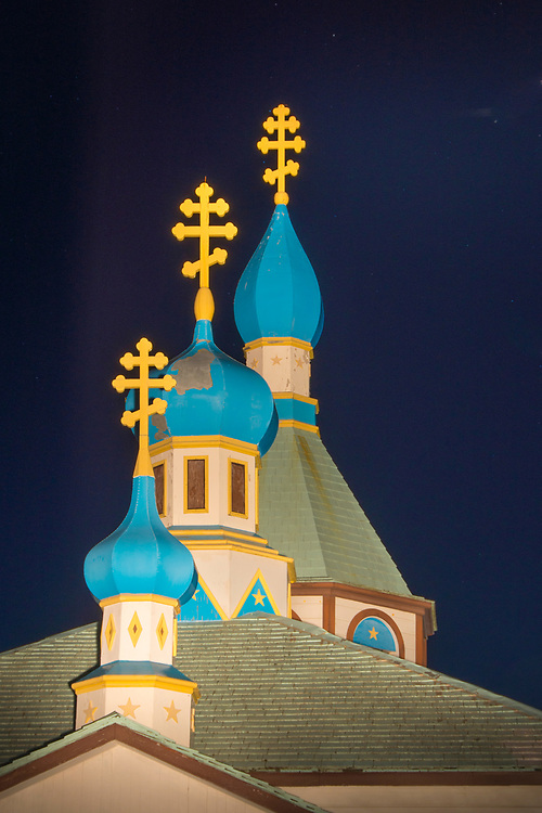 The onion domes on the Russian Orthodox church in Kenai, Alaska, stand out using light painting night photography technique.