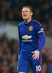 LONDON, ENGLAND - Saturday, November 22, 2014: Manchester United's Wayne Rooney in action against Arsenal during the Premier League match at the Emirates Stadium. (Pic by David Rawcliffe/Propaganda)