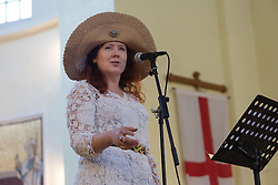 © Licensed to London News Pictures. 26/05/2016. LONDON, UK.  Feminist activist and organiser of the first Jack the Ripper museum protest, JEMIMA BROADBRIDGE speaks at the launch of 'East End Women: The Real Story' exhibition at St George-in-the-East church in Shadwell. The exhibition is a response by the East End Women's Collective and 38 Degrees following a series of protests against the nearby controversial Jack the Ripper museum, which had promised to celebrate east end women, but activists opposed and claimed glorified violence against women. A number of feminist groups and activists are still campaigning to get the  Jack the Ripper museum closed. The exhibition runs until 9th July 2016.  Photo credit: Vickie Flores/LNP