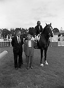 "08/08/1987<br /> 08/08/1987<br /> 08 August 1987<br /> RDS Horse Show, Ballsbridge, Dublin. The Guinness Championship Tankards. Sylvia Bodell, wife of Ernest Bodell (2nd left) Director of Guinness Ireland, presenting the Guinness Championship Gold Tankard for the leading international rider of the Dublin Horse Show 1987, to Eddie Macken (Ireland) on ""Carroll's Flight""."
