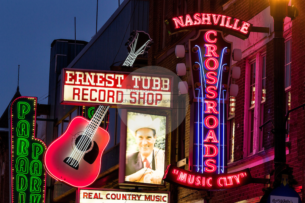 Neon signs for Ernest Tubbs Record Store, Crossroads and other honky-tonks on lower Broadway in Nashville, TN.