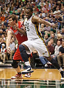 Jazz center Al Jefferson (25) boxes out against Rockets center Omer Asik (3) during the second half of the NBA game between the Jazz and the Houston Rockets, Monday, Nov. 19, 2012.