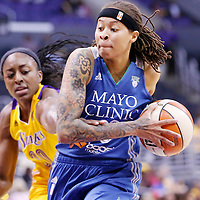 17 June 2014: Minnesota Lynx guard Seimone Augustus (33) drives past Los Angeles Sparks forward Nneka Ogwumike (30) during the Minnesota Lynx  94-77 victory over the Los Angeles Sparks, at the Staples Center, Los Angeles, California, USA.
