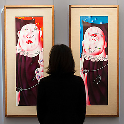 "© Licensed to London News Pictures. 25/11/2016. London, UK. A staff member views ""Circus (Diptych)"" (est. GBP 80-120k), by Oleg Tselkov, from the Bar-Gera Collection, at the preview of artworks from Sotheby's upcoming Russian sales in New Bond Street, where over three hundred works spanning several centuries will be offered. Photo credit : Stephen Chung/LNP"