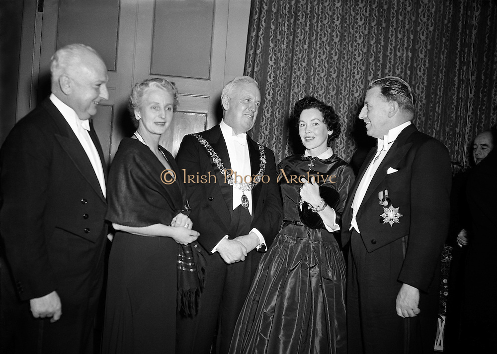Cardinal Spellman receives Honorary Degree from National University of Ireland at Iveagh House, Dublin. Sean Lemass (right) Maureen O'Sullivan (second from right) Cardinal Spellman (centre).28/10/1953  ..Francis Joseph, Cardinal Spellman (04/05/1889?02/12/1967) was an American prelate of the Roman Catholic Church. He was the sixth Archbishop of New York from 1939 to 1967, having previously served as an auxiliary bishop of the Archdiocese of Boston (1932-39). He was created a cardinal in 1946...Francis Spellman was born in Whitman, Massachusetts, to William and Ellen (née Conway) Spellman. His father (1858-1957), whose own parents had immigrated to the United States from Clonmel and Leighlinbridge in Ireland, worked in shoemaking before becoming a grocer. The eldest of five children, Francis had two brothers, Martin and John, and two sisters, Marian and Helene. ..Maureen O'Sullivan (second from right) was Maureen Paula O'Sullivan (17/05/1911 - 23/06/1998) was an Irish actress. She was born in Boyle, County Roscommon, Ireland, the daughter of Roman Catholic parents She attended a convent school in Dublin where one of her classmates was Vivien Leigh. ..O'Sullivan's film career began when she met motion picture director Frank Borzage who was doing location filming on Song o' My Heart for 20th Century Fox. He suggested she take a screen test. She did and won a part in the movie, which starred Irish tenor John McCormack. She then traveled to the United States to complete the movie in Hollywood..O'Sullivan appeared in six movies at Fox, then made three more at other movie studios. In 1932, she signed a contract with Metro-Goldwyn-Mayer. After several roles there and at other movie studios, she was chosen by Irving Thalberg to appear as Jane Parker in Tarzan the Ape Man opposite co-star Johnny Weissmuller, with whom she had a brief affair during the early 1930s. Besides playing Jane, she was one of the more popular ingenues at MGM throughout the 1930s and appear