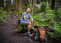 An athletic woman resting on the Little Si trail, Washington, USA.