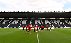 """Southampton platers inspect the pitch before a pre season friendly match at Pride Park, Derby. PRESS ASSOCIATION Photo. Picture date: Saturday July 21, 2018. Photo credit should read: Anthony Devlin/PA Wire. EDITORIAL USE ONLY No use with unauthorised audio, video, data, fixture lists, club/league logos or """"live"""" services. Online in-match use limited to 75 images, no video emulation. No use in betting, games or single club/league/player publications."""