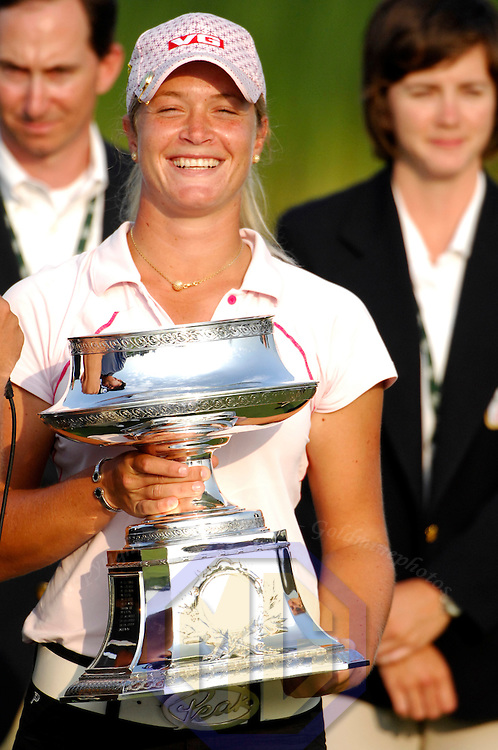 10 June 2007:  Suzann Pettersen holds up her trophy after winning her first major tournament at the McDonald's LPGA Championship. Pettersen of Norway won by one stroke after shooting a 14 under par at Bulle Rock Golf Course in Havre de Grace, Md. .  ****For Editorial Use Only****