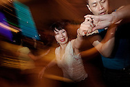 Couples dancing salsa at a party following a competition. Salsa has become indreasingly popular over the past years. Chinese couples are now taking part in International competitions and salsa clubs have appeared in China's major cities.