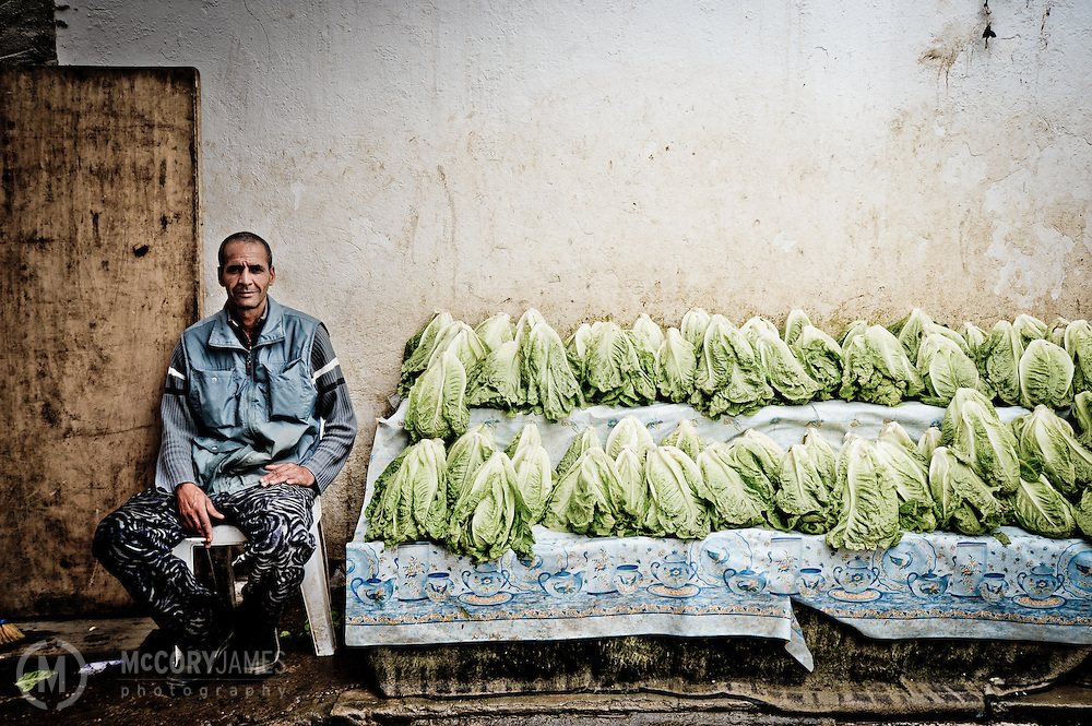 A Tunisian man sells lettuce at a market in Jen Douba, Tunisia