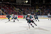 KELOWNA, CANADA - JANUARY 30: Trevor Wong #14 of the Kelowna Rockets skates with the puck against the Seattle Thunderbirds  on January 30, 2019 at Prospera Place in Kelowna, British Columbia, Canada.  (Photo by Marissa Baecker/Shoot the Breeze)