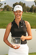 March 27, 2005; Rancho Mirage, CA, USA;  15 year old amateur Michelle Wie Michelle Wie poses with her trophy for low amateur for the tournament at the LPGA Kraft Nabisco golf tournament held at Mission Hills Country Club.  Wie shot a 1 under par 71 for the day and an even par 288 for the tournament and finished tied for 14th overall.<br />Mandatory Credit: Photo by Darrell Miho <br />&copy; Copyright Darrell Miho