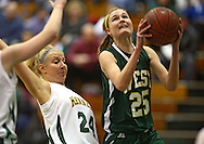 West's Tatum Klein (25) puts up a shot as Kennedy's Valerie Ross (24) defends during their game at Kennedy High School, 4545 Wenig Rd NE in Cedar Rapids on Tuesday evening, February 8, 2011. Iowa City West defeated Cedar Rapids Kennedy 62-53. (Stephen Mally/Freelance)