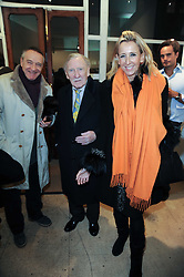 Centre & right, LESLIE PHILLIPS and CAROLINE ST.GEORGE at a Pop Up exhibition of Fine Art held at the Broadbent Gallery, 25 Chepstow Corner, Chepstow Place, London W2 on 7th December 2010.