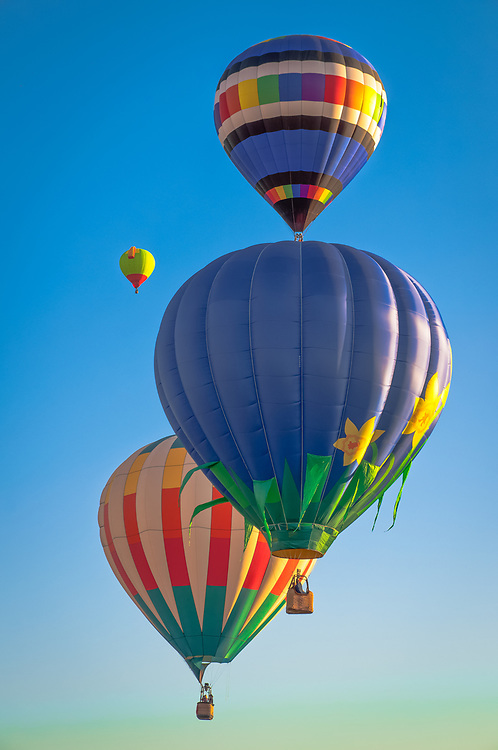 A picture of hot air balloons flying in the sky.<br />