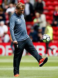 Liverpool manager Jurgen Klopp kicks a ball during the warm up - Mandatory by-line: Matt McNulty/JMP - 21/05/2017 - FOOTBALL - Anfield - Liverpool, England - Liverpool v Middlesbrough - Premier League