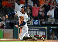 Houston Astros' George Springer celebrates scoring a run on Jose Altuve's RBI double during the first inning of a baseball game against the Baltimore Orioles, Saturday, May 27, 2017, in Houston. (AP Photo/Eric Christian Smith)