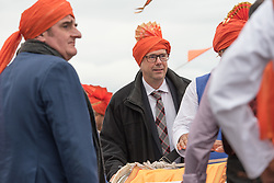 The Scottish Ganesh Festival took to the streets of Portobello in a colourful procession that made it's way down to the sea from the Town Hall. The procession was joined by local MP Tommy Shepphard and Edinburgh councillor and former lord provost Donald Wilson. Pictured Donald Wilson<br /> © Jon Davey/ EEm