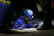 KATHMANDU, NEPAL - APRIL 29: (CHINA OUT) <br /> <br /> Rescue Operations Continue Following Devastating Nepal Earthquake<br /> <br /> Rescue workers of China's Blue Sky Rescue Team and local people search for lives at a collapsed supermarket on April 29, 2015 in Kathmandu, Nepal. A major 7.8 earthquake hit Kathmandu mid-day on Saturday, and was followed by multiple aftershocks that triggered avalanches on Mt. Everest that buried mountain climbers in their base camps. Many houses, buildings and temples in the capital were destroyed during the earthquake, leaving thousands dead or trapped under the debris as emergency rescue workers attempt to clear debris and find survivors. Regular aftershocks have hampered recovery missions as locals, officials and aid workers attempt to recover bodies from the rubble.<br /> ©Exclusivepix Media