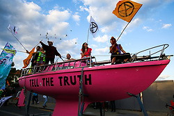 "© Licensed to London News Pictures. 08/09/2019. London, UK. Extinction Rebellion climate change activists on the <br /> pink ""Tell the Truth"" boat during the march from Turnpike Lane station to Manor House station in north London. Photo credit: Dinendra Haria/LNP"