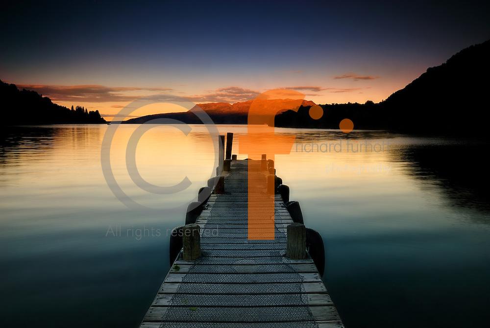 Richard Furhoff 100101_NewZealand_DSC3649.tif.Dock at sunset, Lake Tarawera, looking toward Mt Tarawera.