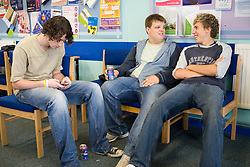 Teenage boys; taking a break; chatting in the school common room,