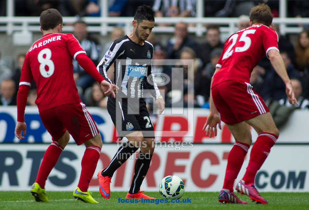 Remy Cabella (C) of Newcastle United on the attack against  West Bromwich Albion during the Barclays Premier League match at St. James's Park, Newcastle<br /> Picture by Stephen Gaunt/Focus Images Ltd +447904 833202<br /> 09/05/2015
