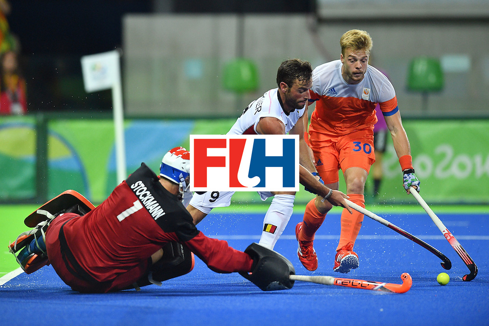 Belgium's Sebastien Dockier (C) vies with Netherland's Jaap Stockmann (L) and Netherland's Mink van der Weerden during the men's semifinal field hockey Belgium vs Netherlands match of the Rio 2016 Olympics Games at the Olympic Hockey Centre in Rio de Janeiro on August 16, 2016.  / AFP / Carl DE SOUZA        (Photo credit should read CARL DE SOUZA/AFP/Getty Images)