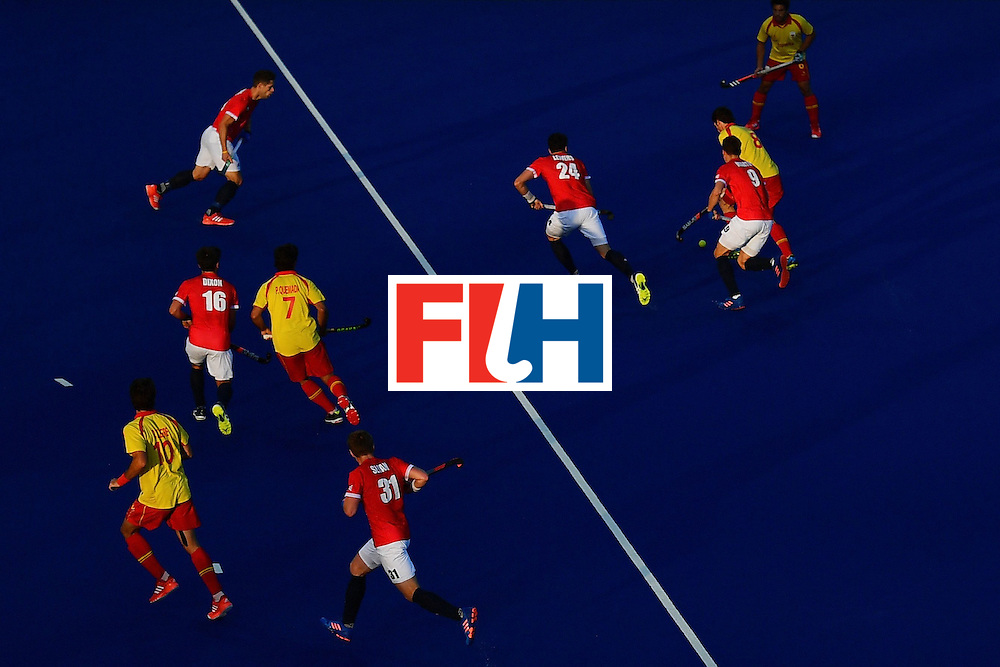 Great Britain's Harry Martin and Spain's Vicenc Ruiz vie during the mens's field hockey Britain vs Spain match of the Rio 2016 Olympics Games at the Olympic Hockey Centre in Rio de Janeiro on August, 12 2016. / AFP / Carl DE SOUZA        (Photo credit should read CARL DE SOUZA/AFP/Getty Images)