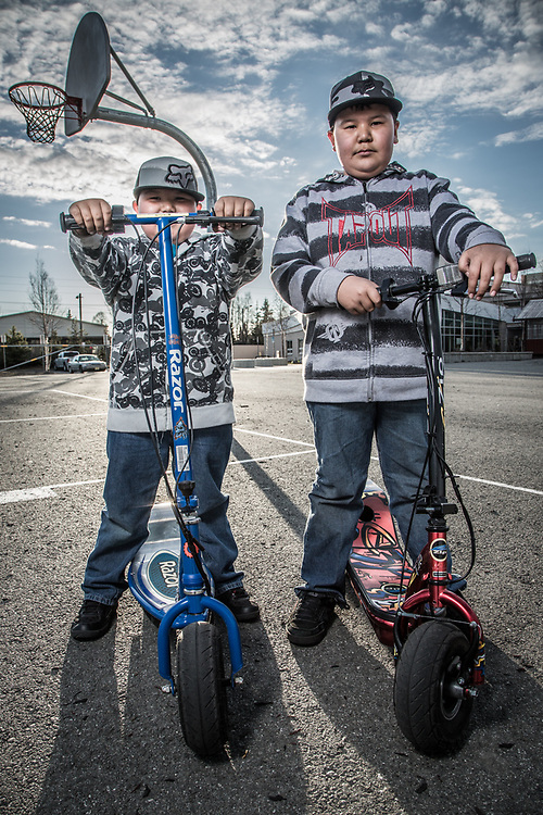 Brothers Brendon and Corey Ransdell  with their electric skooters at Chugach Elementary School, Anchorage