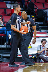 NORMAL, IL - January 07: Chance Moore stands ready to restart the game as Bert Smith is still cleaning up Bud Light from the floor during a college basketball game between the ISU Redbirds and the University of Missouri State Bears on January 07 2020 at Redbird Arena in Normal, IL. (Photo by Alan Look)