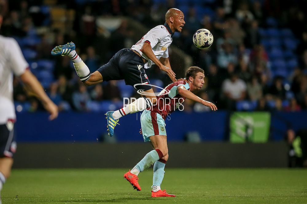 Alex Finney (Bolton Wanderers) gets a flying header above the Burnley player during the Pre-Season Friendly match between Bolton Wanderers and Burnley at the Macron Stadium, Bolton, England on 26 July 2016. Photo by Mark P Doherty.