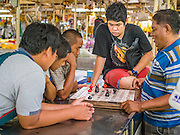 21 OCTOBER 2014 - BANGKOK, THAILAND:  Men play chess in the Pak Khlong Talat market on the Chao Phraya River in Bangkok.   PHOTO BY JACK KURTZ