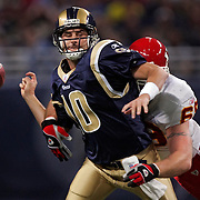 Kansas City Chiefs defensive end Jared Allen, right, stripped the football out of the arm of St. Louis Rams quarterback Marc Bulger, center, in the second quarter on November 5, 2006, at the Edward Jones Dome in St. Louis, Mo. The Chiefs converted the fumble recovery into a Chiefs touchdown, winning 31-17 over the Rams.