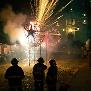 Fireworks in the main street in front of the Church of Santo Tomas as part of Convite 12 de Dicembre in Chichicastenango in celebration of the Day of Our Lady of Guadalupe.. Chichicastenango is an indigenous Maya town in the Guatemalan highlands about 90 miles northwest of Guatemala City and at an elevation of nearly 6,500 feet. It is most famous for its markets on Sundays and Thursdays.