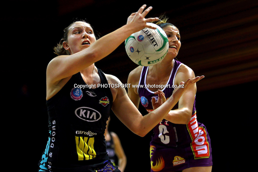 Magic's Khao Watts competes against Firebirds' Kimberley Ravaillion. ANZ Netball Championship, Minor Semifinal, Waikato/Bay of Plenty Magic v Queensland Firebirds, Claudelands Arena, Hamilton, New Zealand. Sunday 30th June 2013. Photo: Anthony Au-Yeung / photosport.co.nz