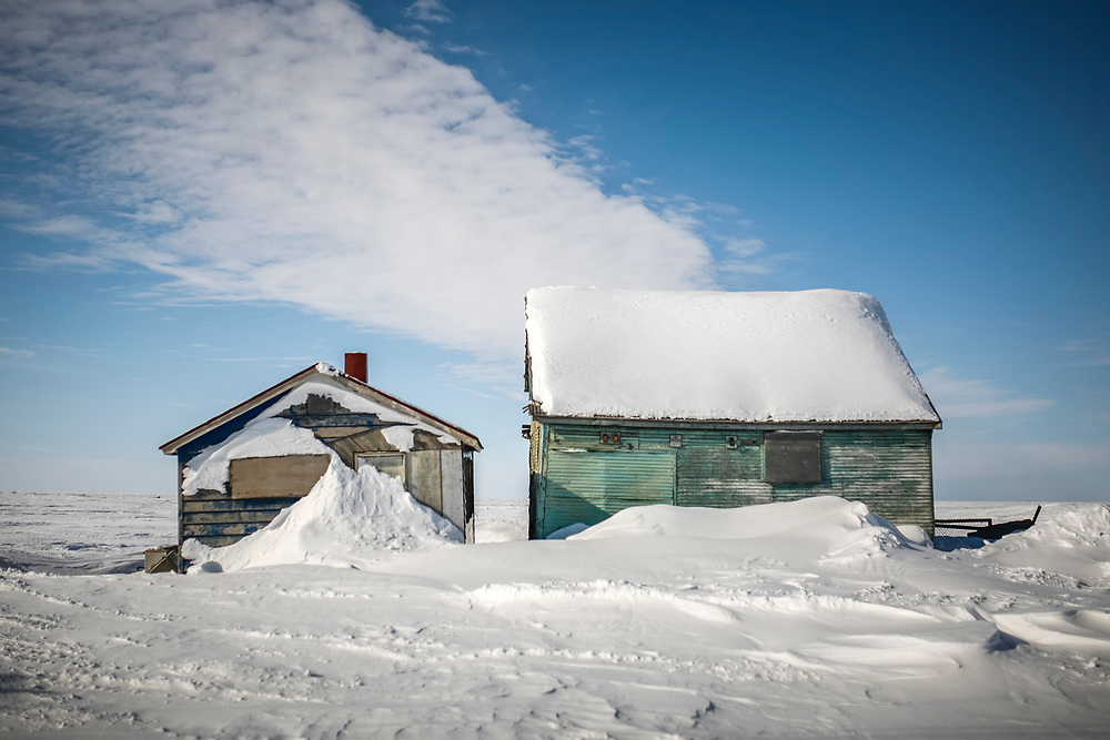 Building are seen covered in snow in Tuktoyaktuk.