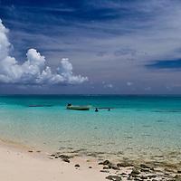 Shot of Aqua Marine Water, Sweeping Clouds, White Sand, Fishing Boat of Fiji Coastline