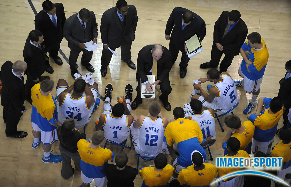 Dec 20, 2011; Los Angeles, CA, USA; UCLA Bruins coach Ben Howland diagrams a play during a timeout against the UC Irvine Anteaters at the Los Angeles Memorial Sports Arena. UCLA defeated UC Irvine 89-60.