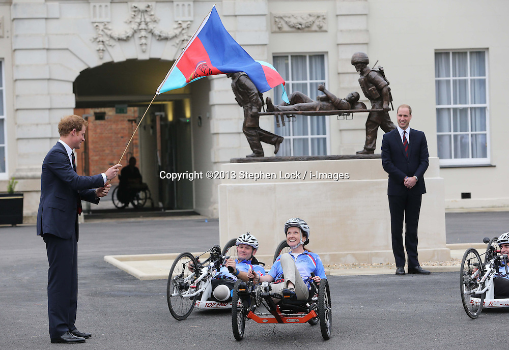 Prince Harry watched by the Duke of Cambridge waves off the 2013 Hero Ride during a visit to the Help For Heroes Recovery Centre in Tidworth, Wiltshire, Monday, 20th May 2013 Picture by:  Stephen Lock / i-Images