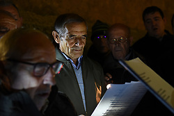 November 1, 2018 - Madrid, Madrid, Spain - Men sing 'Cantos de las Ánimas' (Songs of Souls) during the celebrations of All Saint's Day in the small village of Tajueco, north of Spain. During this old tradition,  villagers sing songs to accompany the souls during their ''way'' from Purgatory to the Heaven. (Credit Image: © Jorge Sanz/Pacific Press via ZUMA Wire)