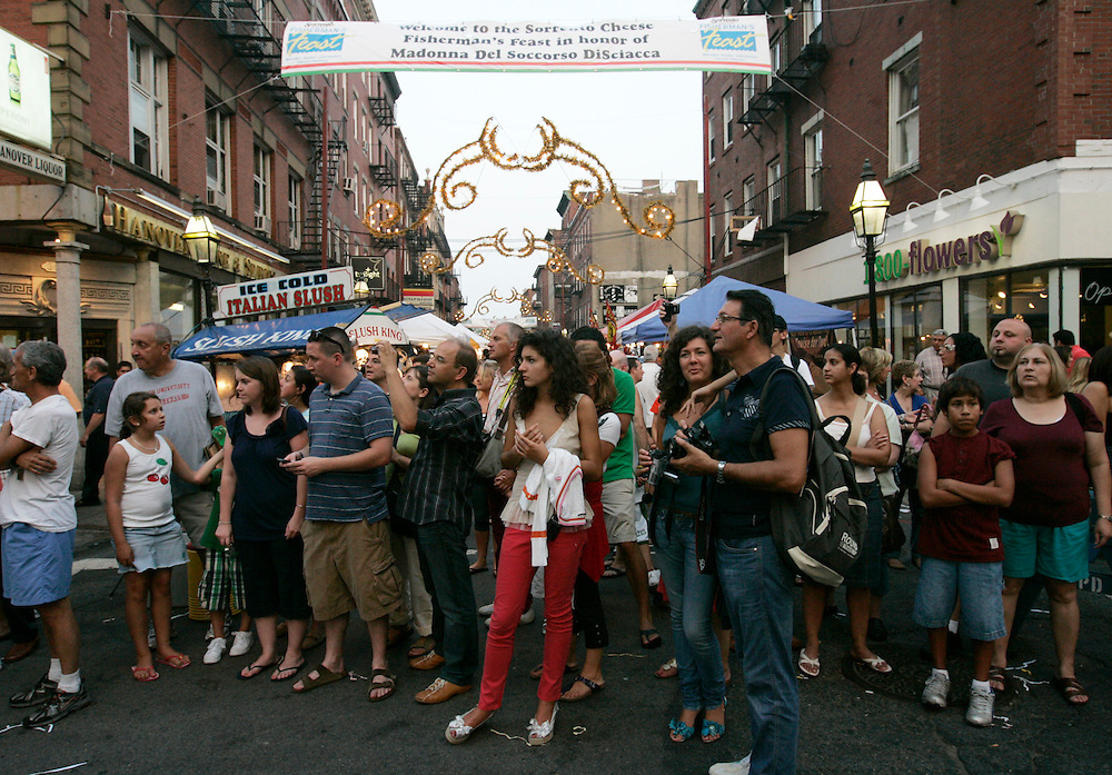 (Boston, MA - 081609) - FESTIVAL - People in the North End celebrate the Fisherman's Feast on North St on Sunday night. ..(081609festival - Herald photo by Will Nunnally and edition)