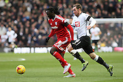 Cardiff City striker Kenwyne Jones heads for goal during the Sky Bet Championship match between Derby County and Cardiff City at the iPro Stadium, Derby, England on 21 November 2015. Photo by Aaron Lupton.