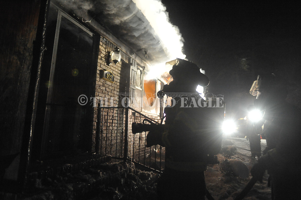 Lafayette County firemen fight a fire at the home of Freddie Pinion at 852 Highway 30 east of Oxford, Miss., on Thursday, January 13, 2011. Everyone escaped the house safely.