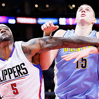 02 October 2015: Los Angeles Clippers forward Josh Smith (5) vies for the rebound with Denver Nuggets center Nikola Jokic (15) during the Los Angeles Clippers 103-96 victory over the Denver Nuggets, in a preseason game, at the Staples Center, Los Angeles, California, USA.
