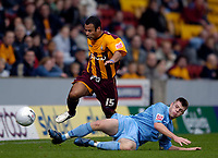 Photo: Jed Wee.<br />Bradford City v Tranmere Rovers. The FA Cup.<br />06/11/2005.<br /><br />Bradford's Ben Muirhead (L) is tackled by Tranmere's Steven Jennings.