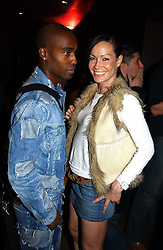 MISS TARA PALMER-TOMKINSON and SIMON WEBBE from pop band Blue at a party to celebrate a new collection of sexy underware by Janet Reger called 'Naughty Janet' held at 5 Cavendish Square, London on 19th October 2004.<br />