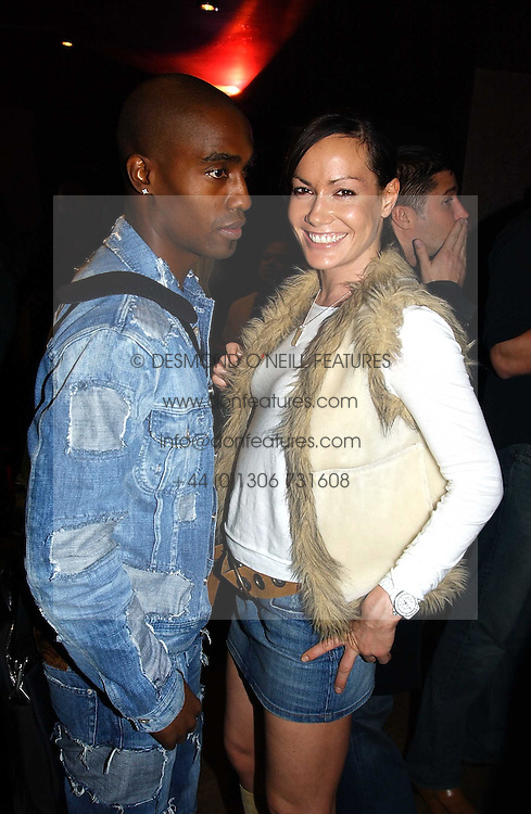 MISS TARA PALMER-TOMKINSON and SIMON WEBBE from pop band Blue at a party to celebrate a new collection of sexy underware by Janet Reger called 'Naughty Janet' held at 5 Cavendish Square, London on 19th October 2004.<br /><br />MINIMUM REPRODUCTION FEE - SEE OUR WEB SITE<br /><br />NON EXCLUSIVE - WORLD RIGHTS-