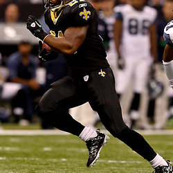 November 21, 2010; New Orleans, LA, USA; New Orleans Saints running back Julius Jones(21) runs against the Seattle Seahawks during the second half at the Louisiana Superdome. The Saints defeated the Seahawks 34-19. Mandatory Credit: Derick E. Hingle