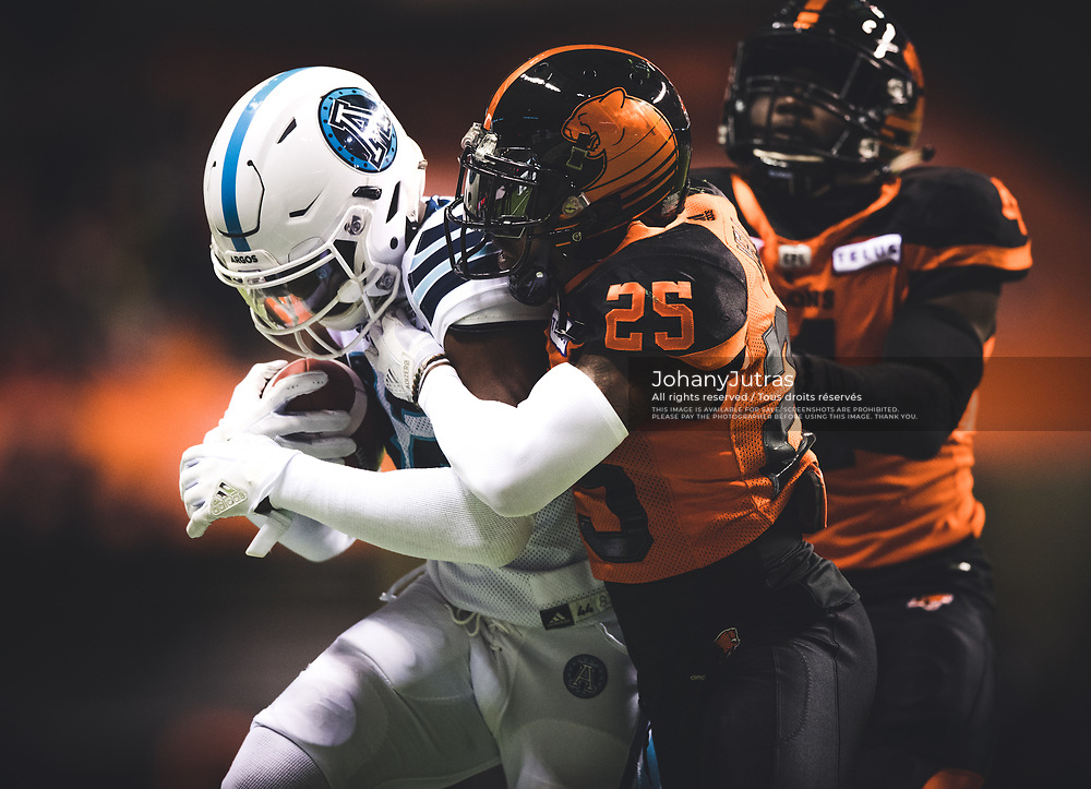 Malcom Williams (82) of the Toronto Argonauts and Ronnie Yell (25) of the BC Lions during the game at BC Place Stadium in Vancouver, BC, Saturday Nov. 4, 2017. (Photo: Johany Jutras)